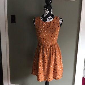 Cute orange and patterned printed midi dress.